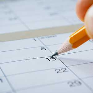 Pencil Marking Date in The Calendar